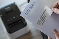 QL-800 label printer with address label printed from Microsoft Excel spreadsheet